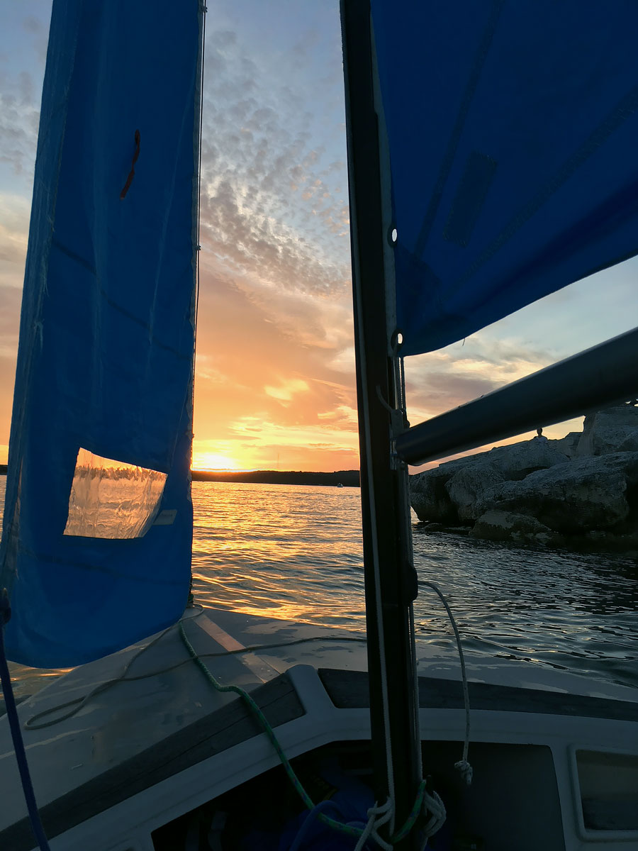 Sailing our Hobie Holder 14 around Starnes Island on Lake Travis in Austin, TX at sunset